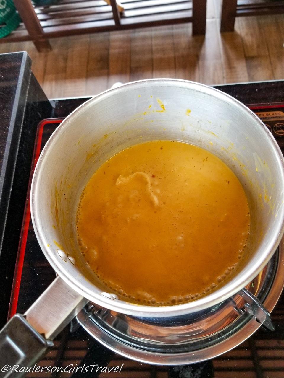 Adding the Crispy Noodles to the Khao Soi