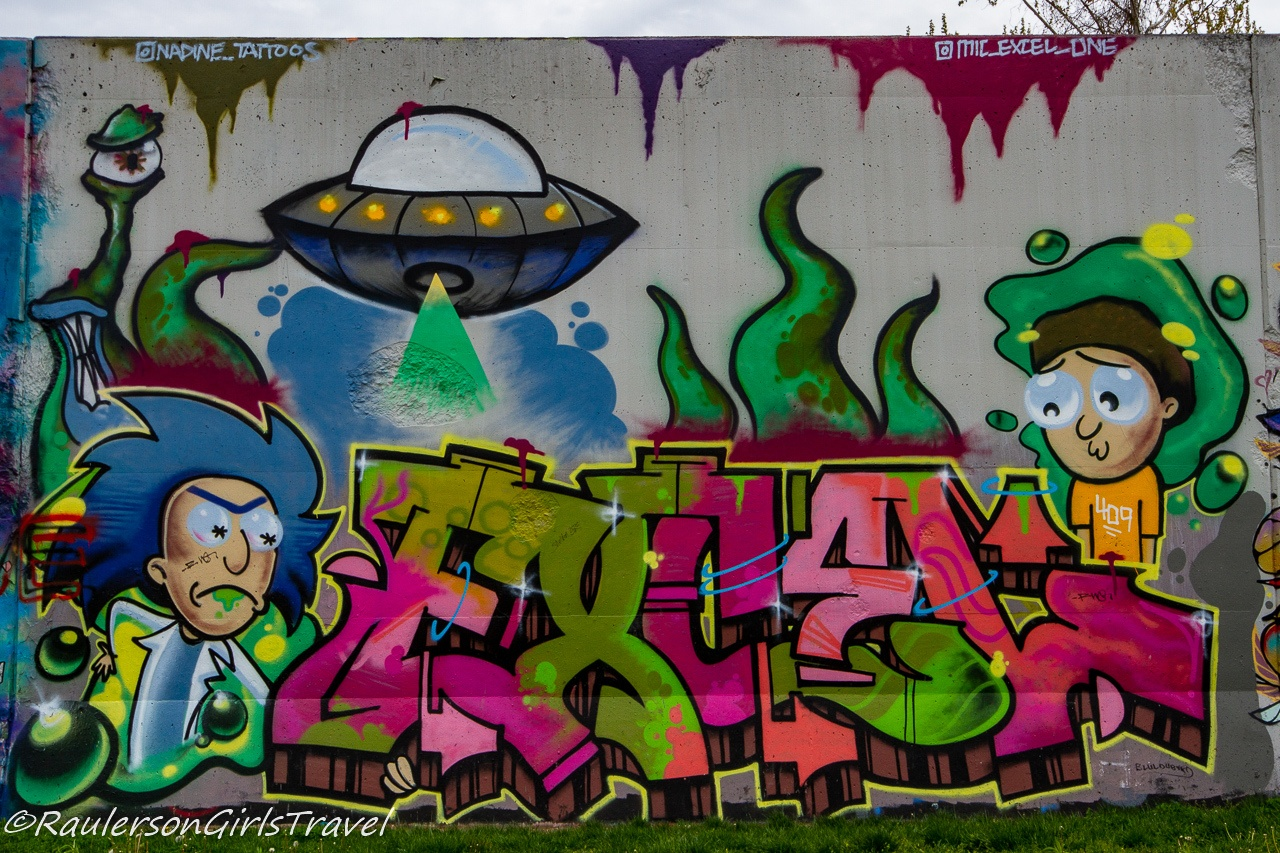 Aliens, Scientists, and kids street art at The Mural Mile