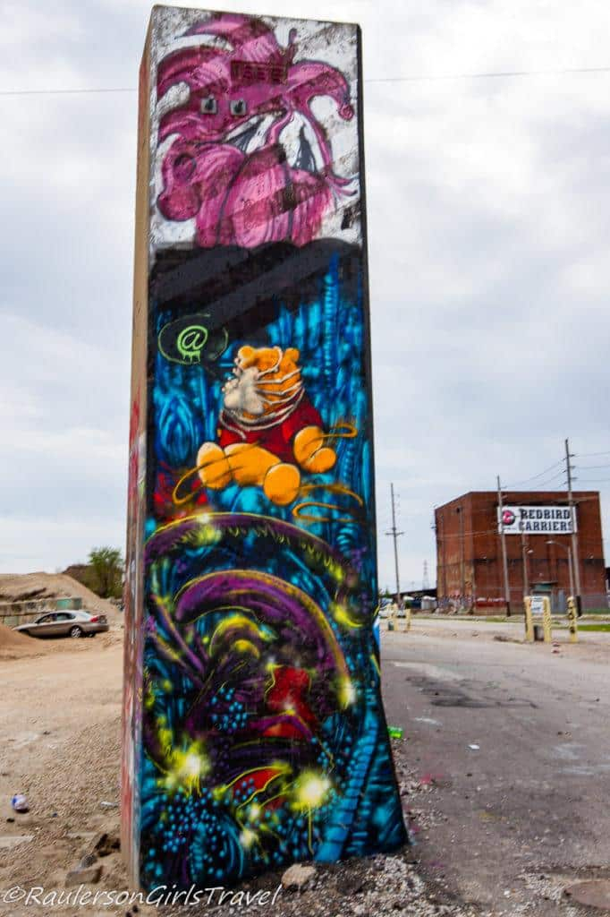 Winnie the Pooh street art on the edge of the flood wall at the Mural Mile