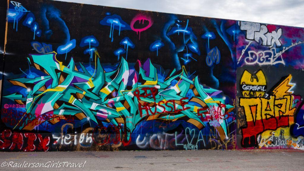 Blue hands street art on The Mural Mile