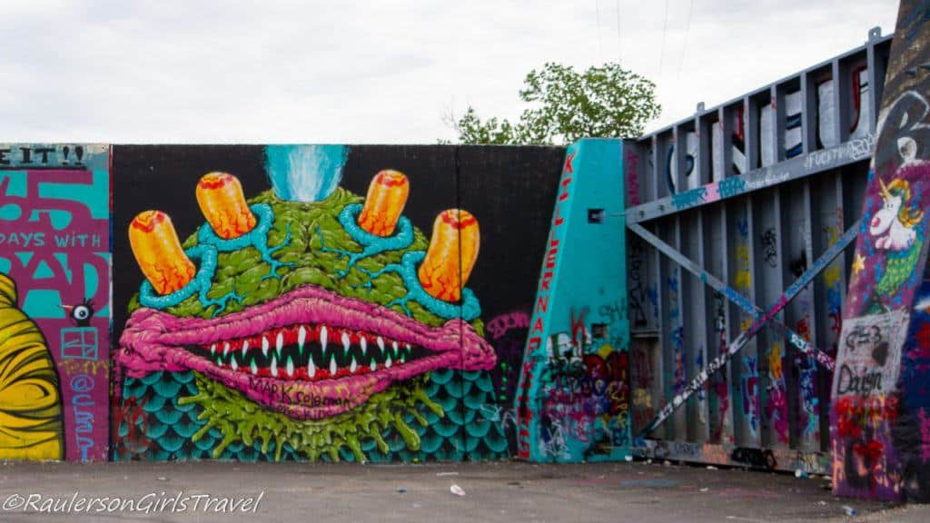 Green monster with Four Eyes Street Art