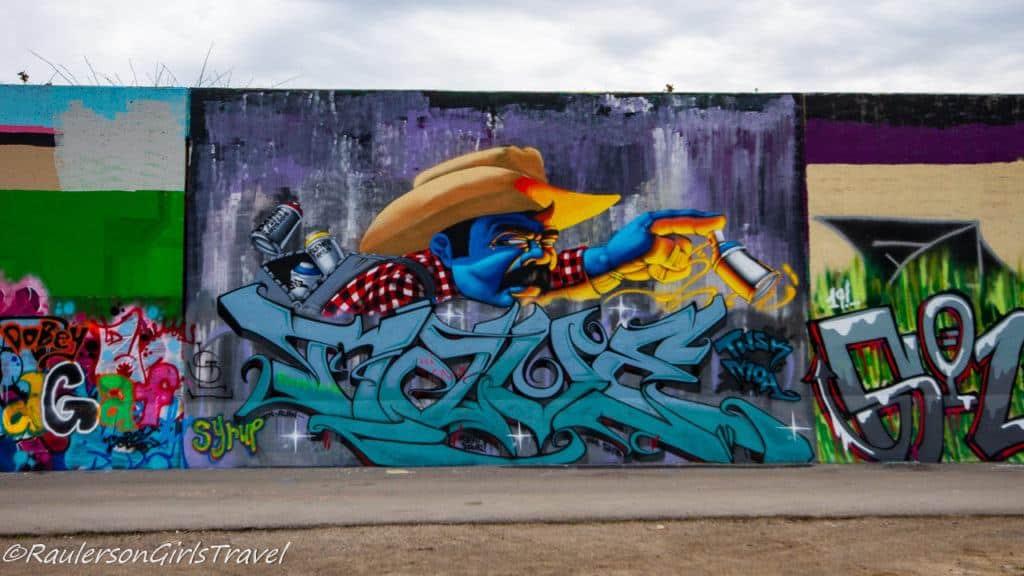 Farmer with paint spray cans street art