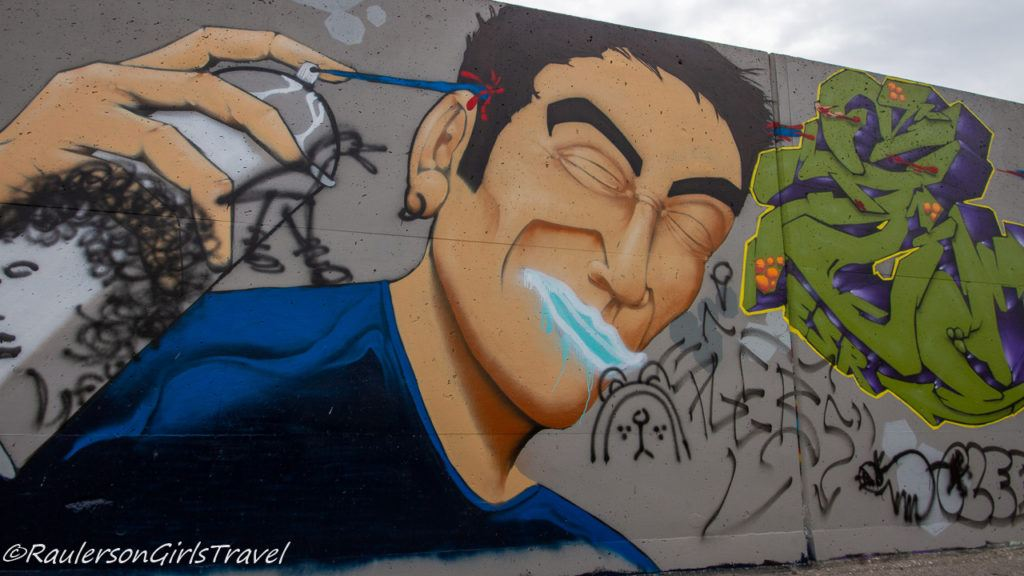 Man with spray can street art
