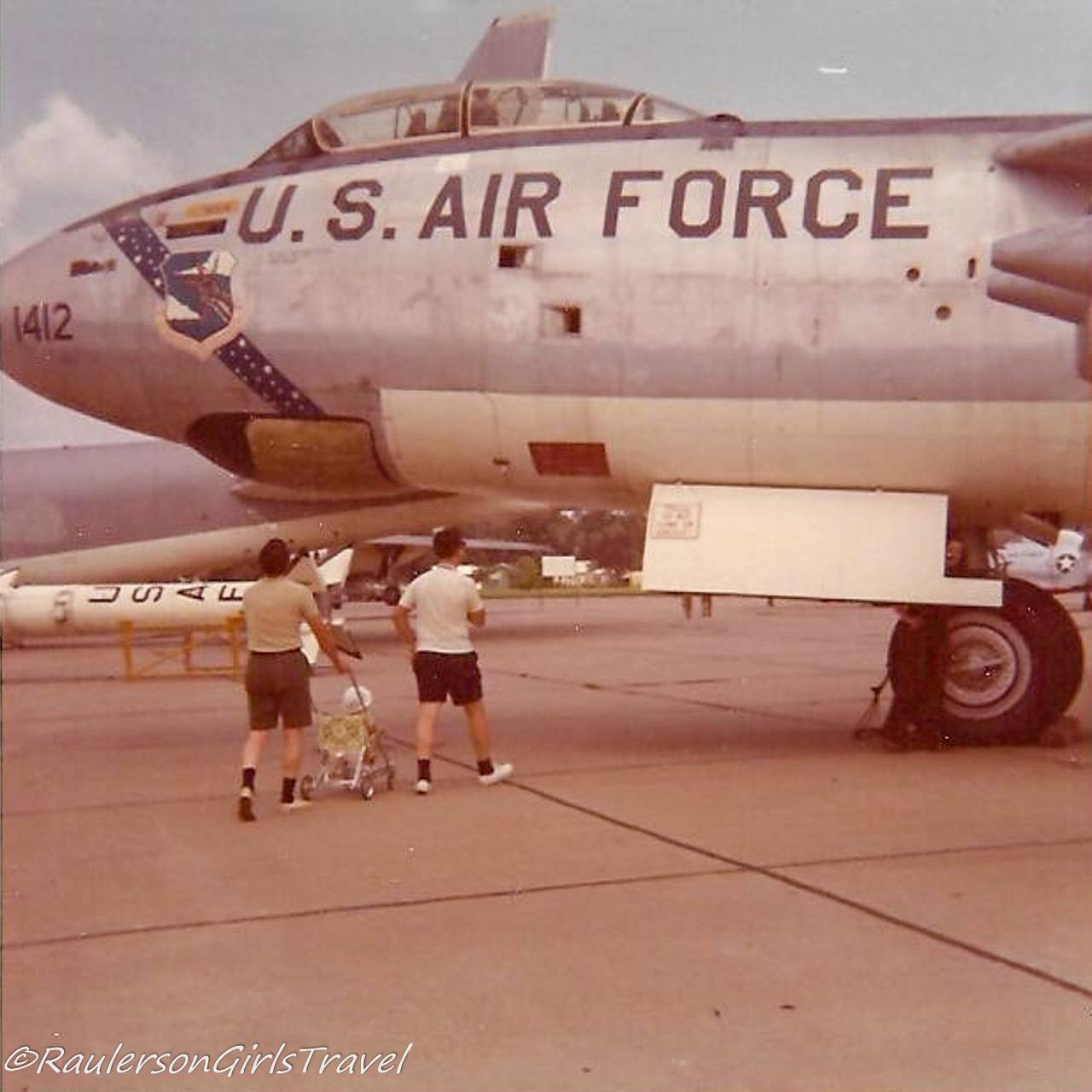 Dad pushing Heather in stroller toward U.S. Air Force plane at an Air Show