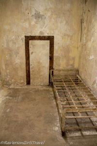 Old bed frame in a jail cell