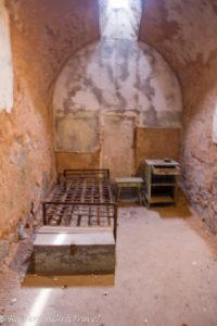 The sparse furnishings of a jail cell