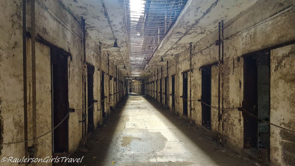 An abandoned cell block with open sky