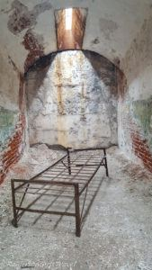 Rundown cell and old bed frame