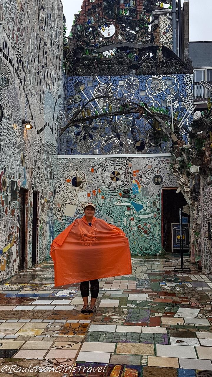 Kayla posing in her rain poncho at Magic Gardens