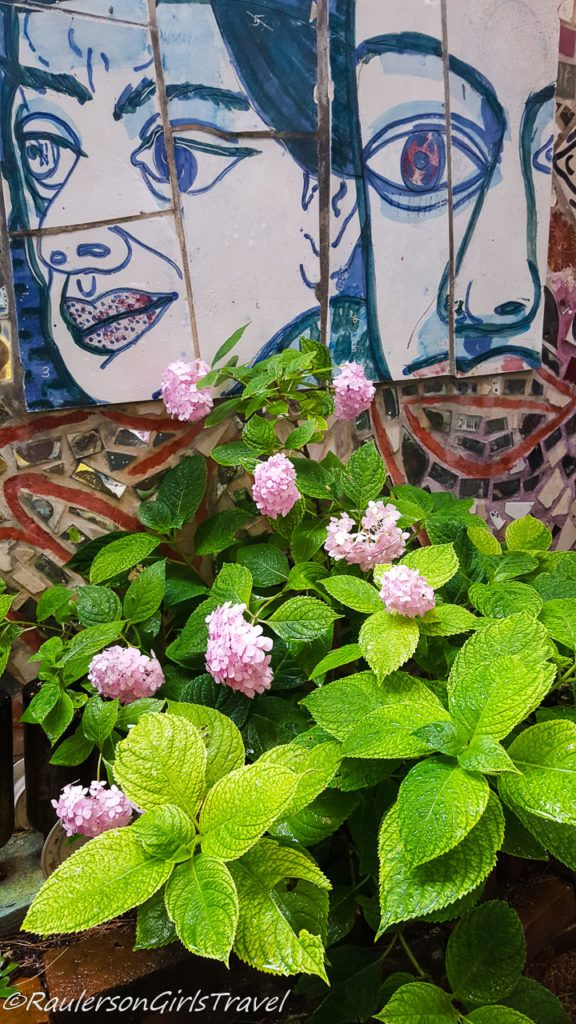 Tiled faces by flowers