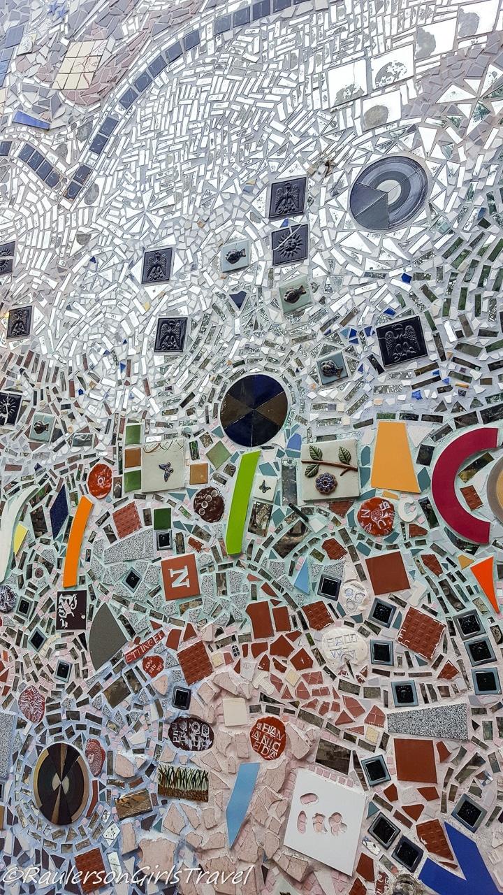 Mirror and mosaic tiled wall