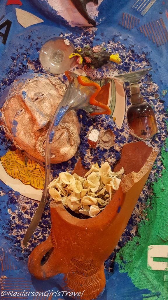 Broken pitcher with flowers