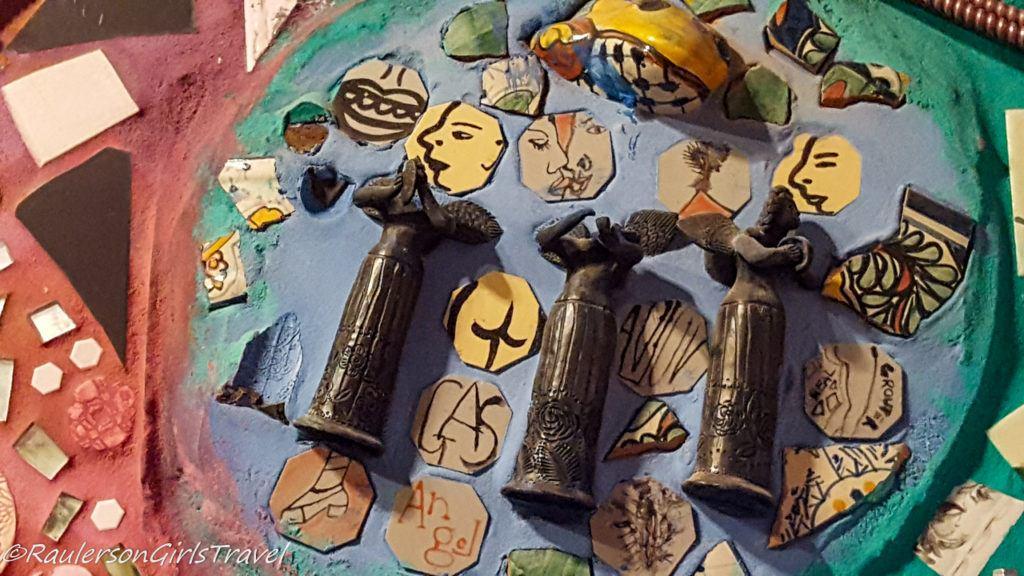 Figurines and tile art display