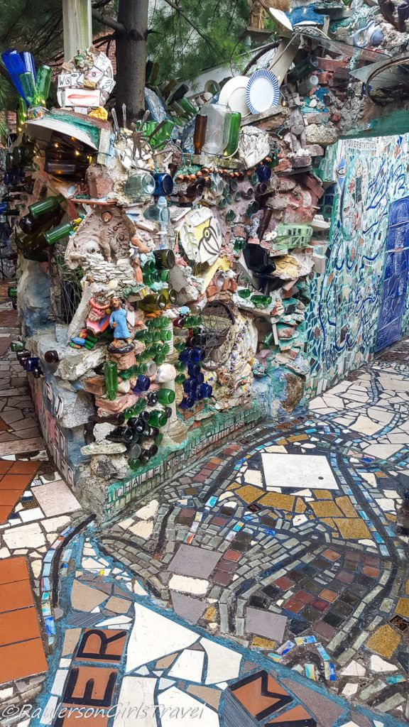 Wall and tile decorated with mosaic tile and bottles
