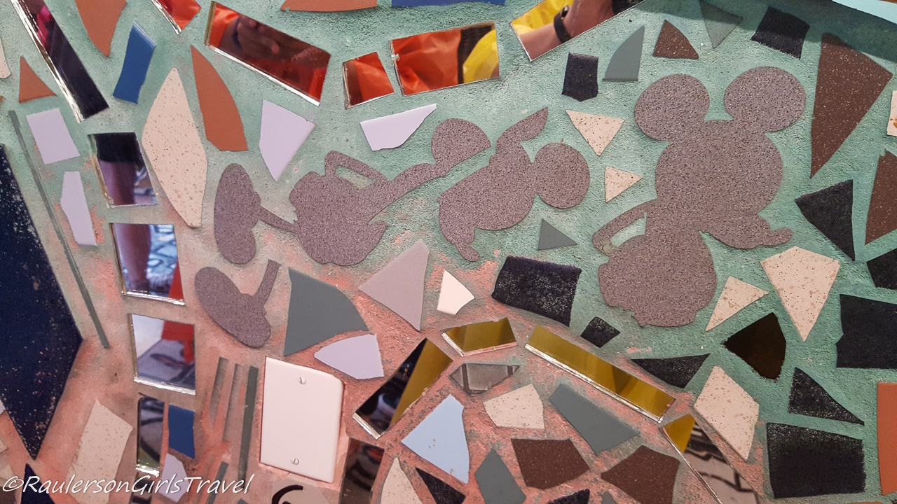 Mickey Mouse silhouettes in mosaic tiles