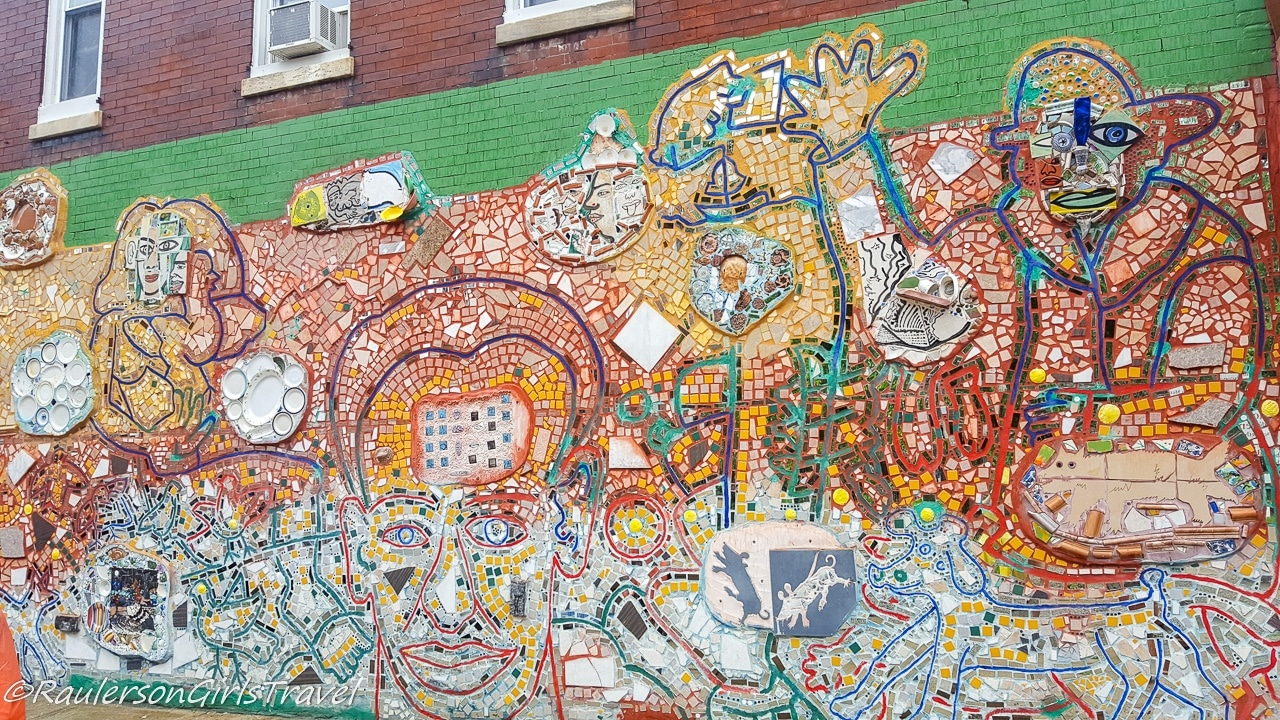 Colorful Mosaic tiled art on the side of a building