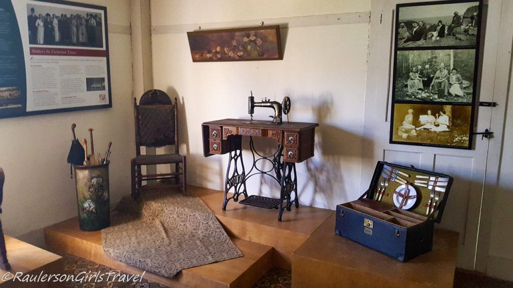 Old fashioned sewing machine, picnic box, and umbrella stand