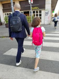 Father and Daughter walking together in Milan, Italy