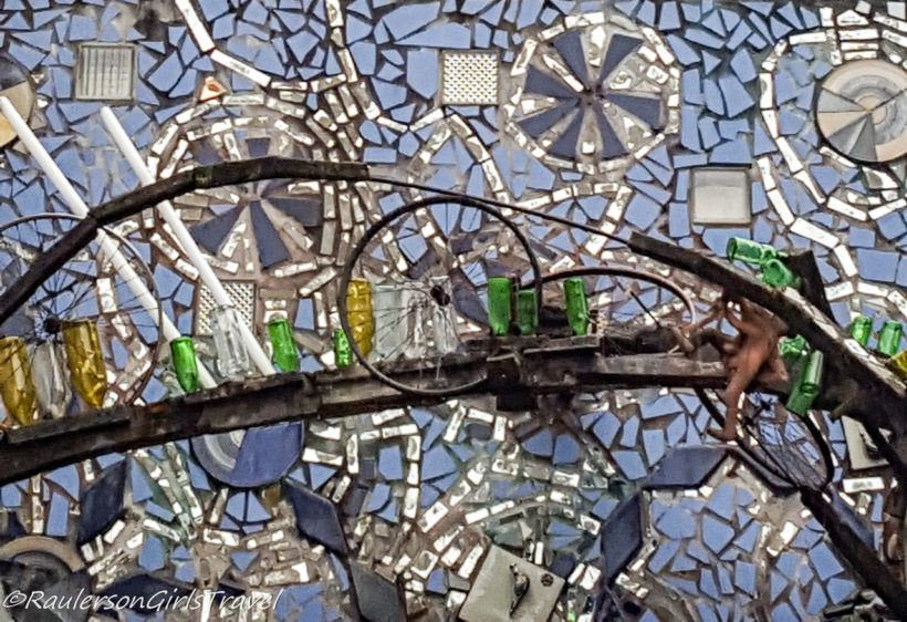 Tiles, mirrors, glass bottles, and bicycle wheels in Philly's Magic Gardens