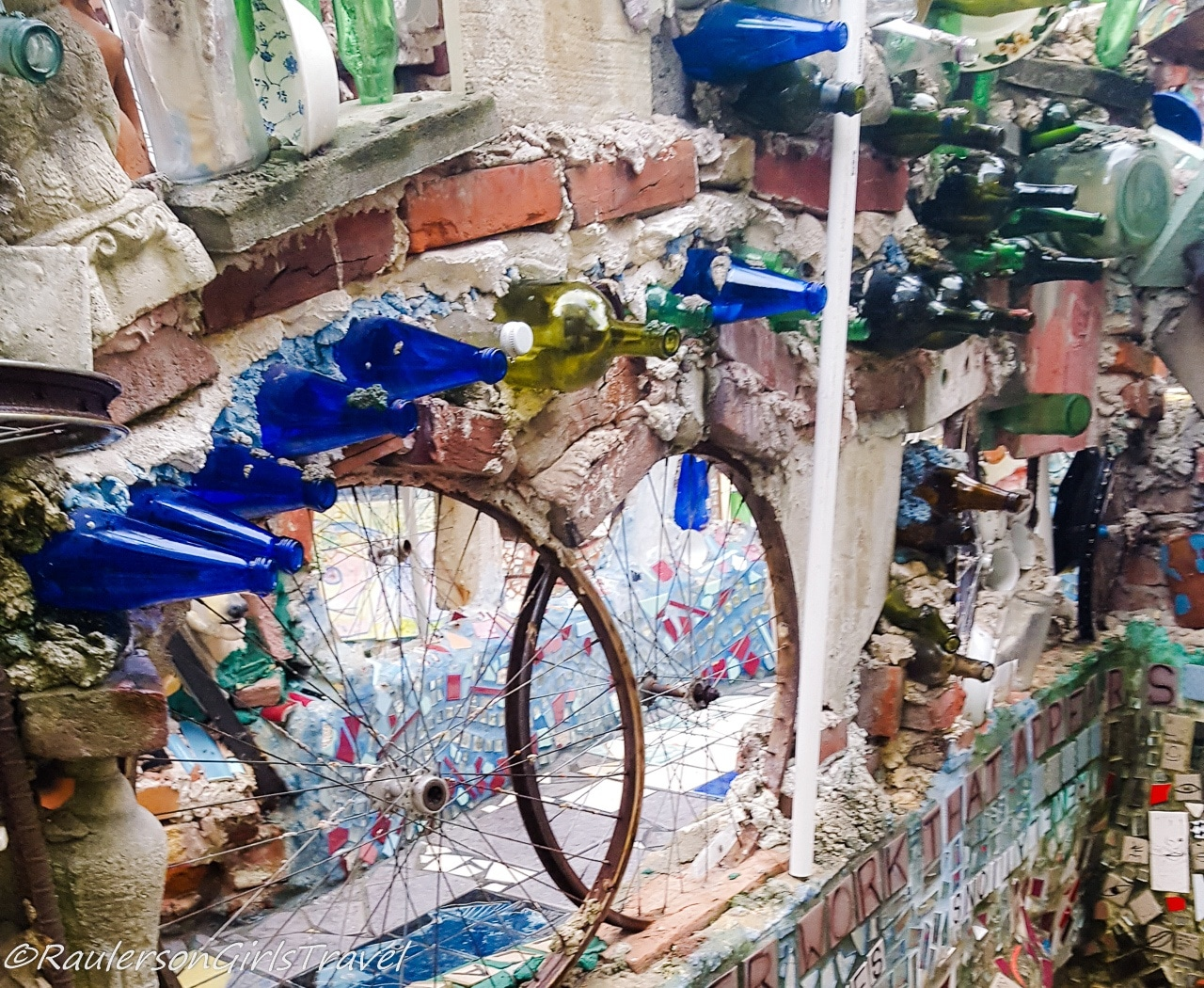 Colorful glass bottles decorating a wall