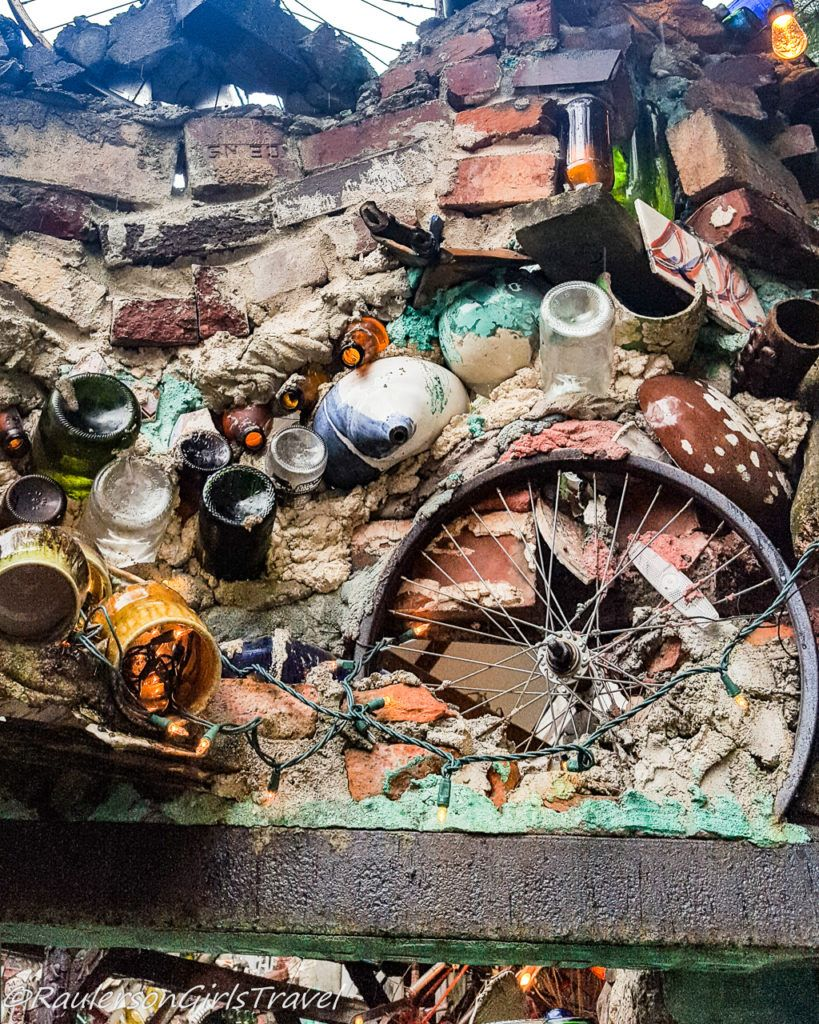 Glass bottles and bicycle wheels as art