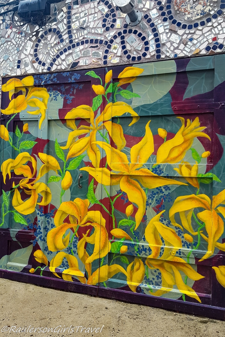 Bright Yellow Flowers painted on a Garage Door