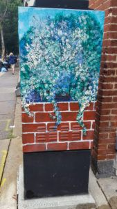 Flowering plant painted on an utility box