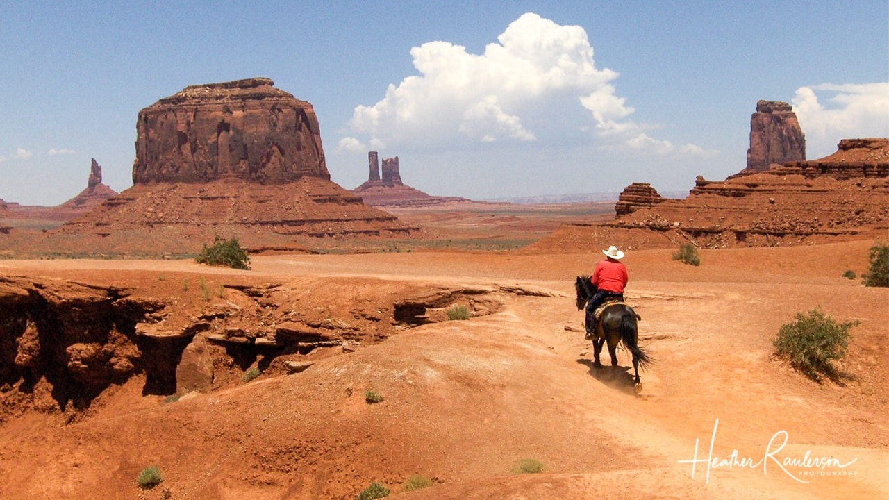 Man riding a horse in Monument Valley