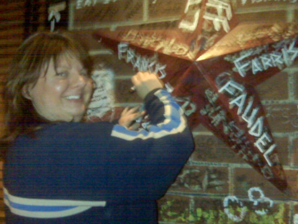 Heather signing name at Gino's East Pizzeria