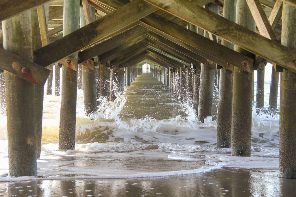 Water splashing under a pier in Myrtle Beach