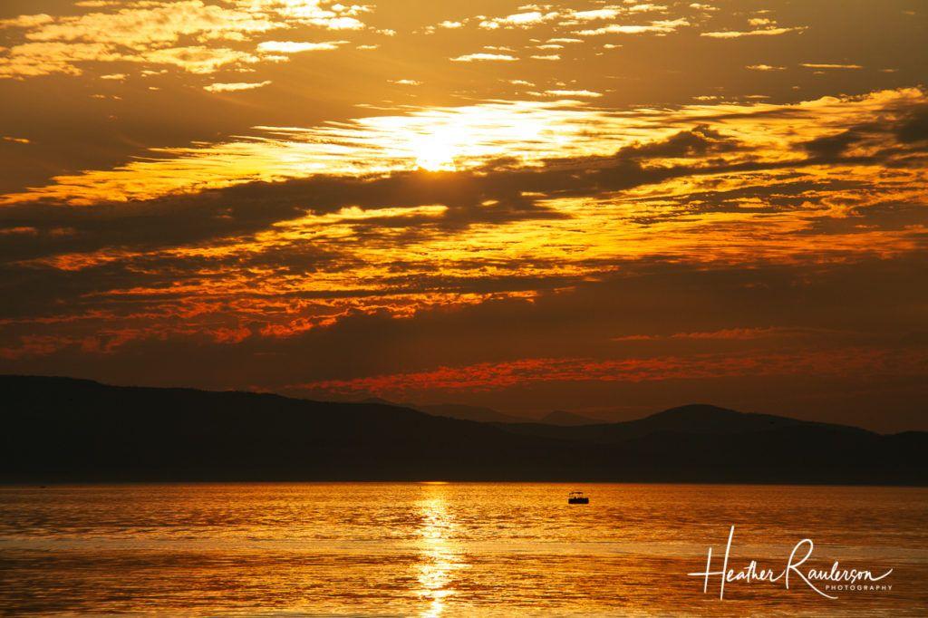 Boat on Lake Champlain at Sunset