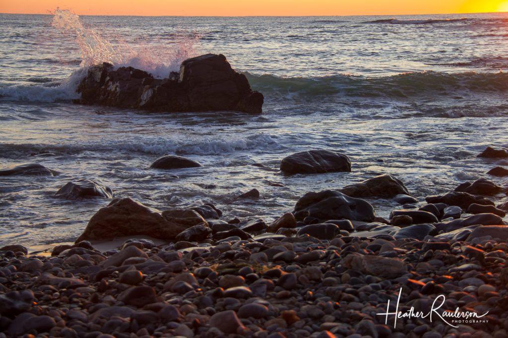 Capturing the sunlight through water crashing on a rock