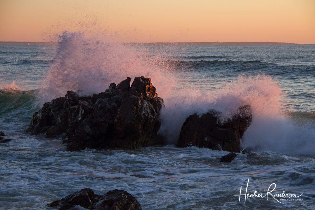 Large Wave crashes into rock during sunrise