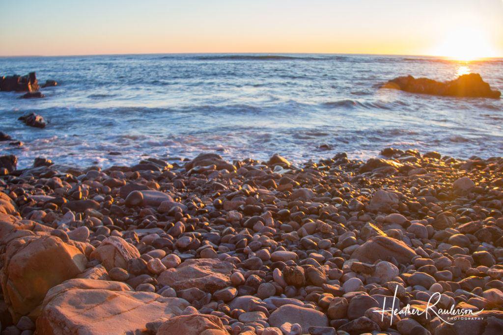 Sunlight captured on pebbles at dawn