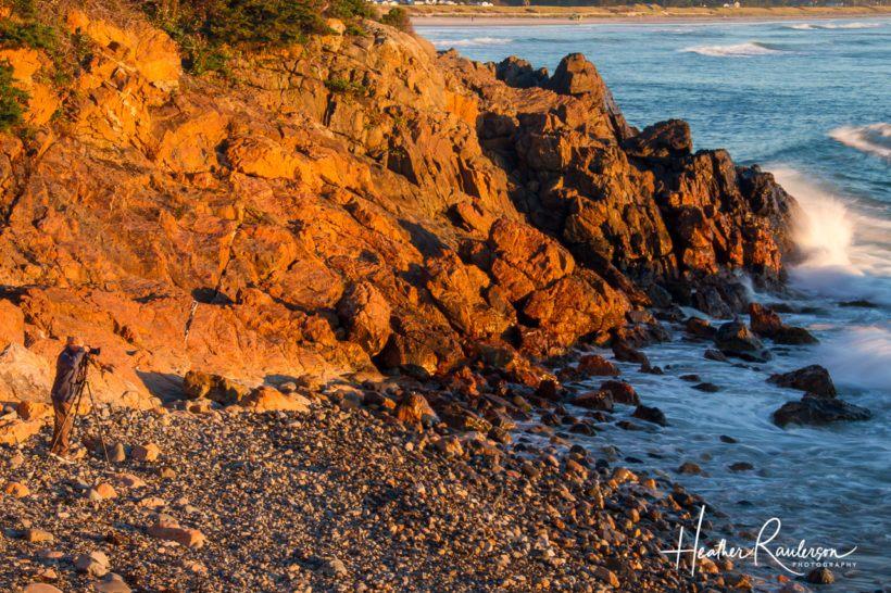 Photographer capturing the sunrise at Marginal Way