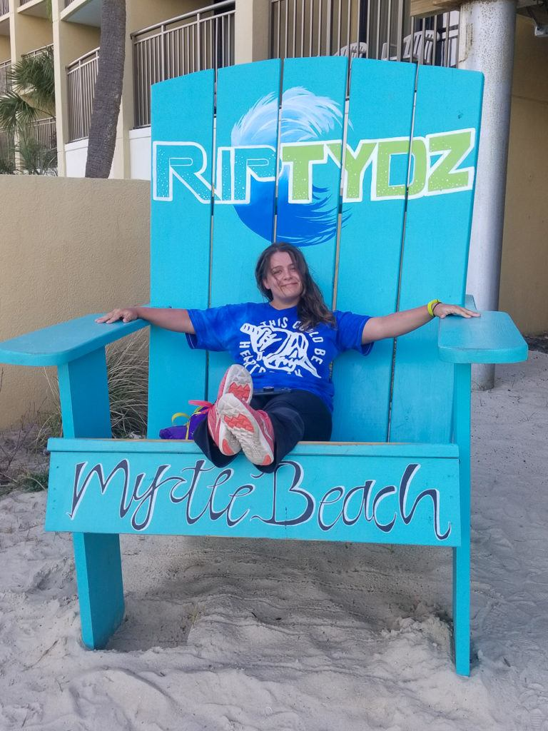 Kayla sitting on the big chair at RipTydz in Myrtle Beach