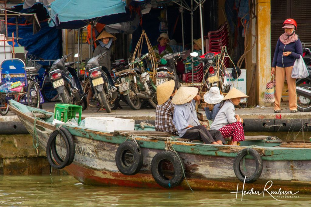 Group of Vietnamese Ladies sitting on a boat