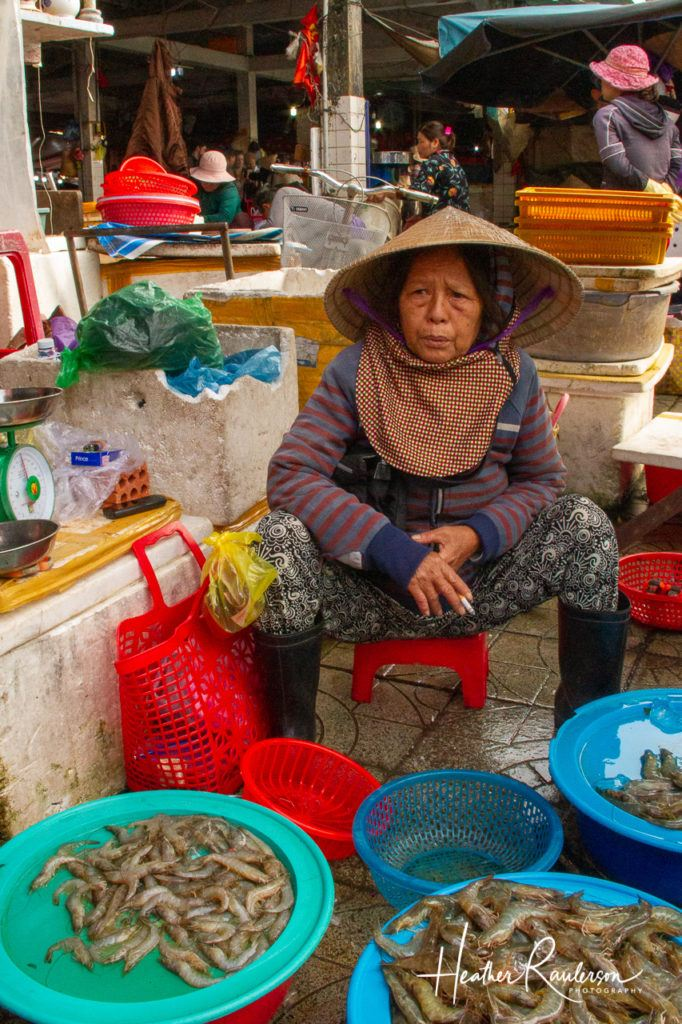 Vietnamese Lady selling seafood at a Hoi An Market