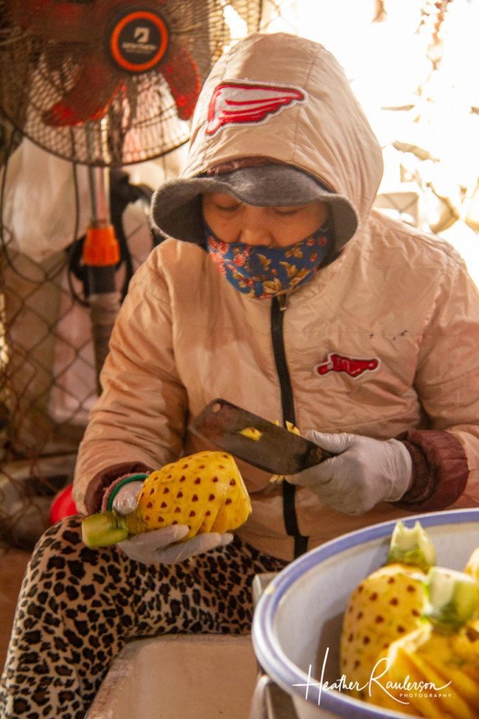 Cutting a Pineapple in a Hoi An Market