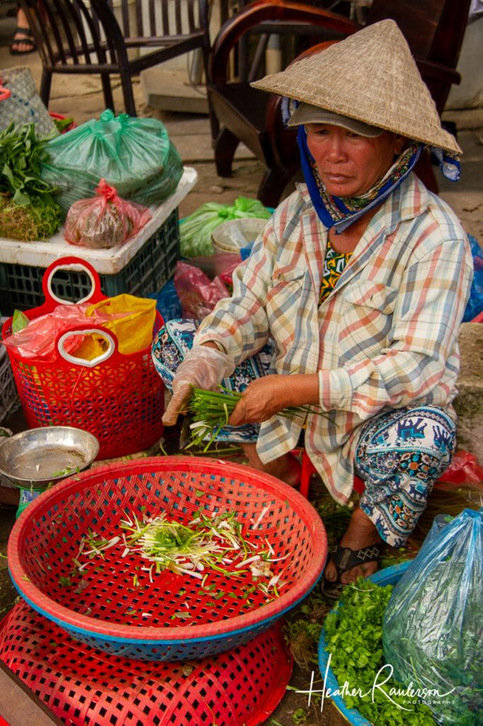 Cutting greens at the Hoi An Market