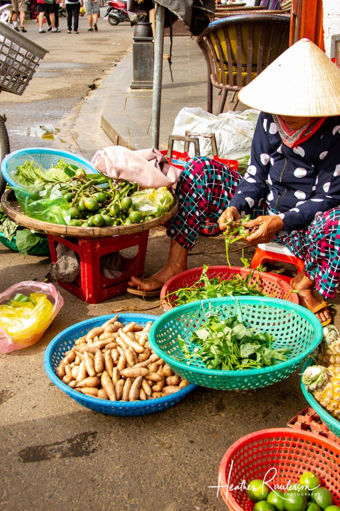 Separating the greens at the Hoi An Market