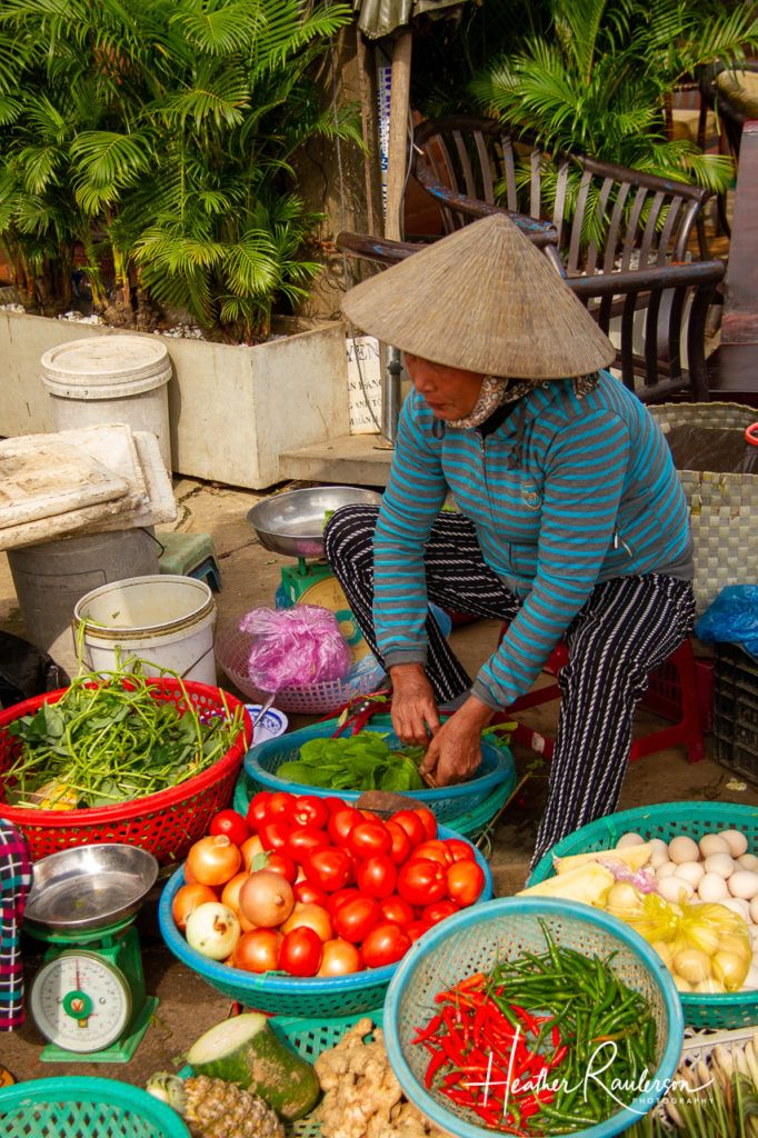 Selling vegetables at the Hoi An Market