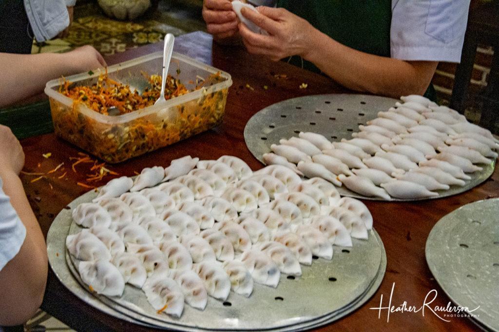 Making dumplings for Ms. Vy's Market Restaurant
