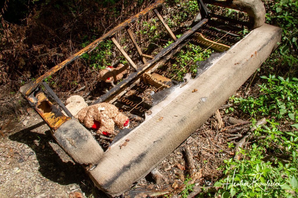 Burnt couch and teddy bear by Gate 4 of the Gates of Hell in Collinsville