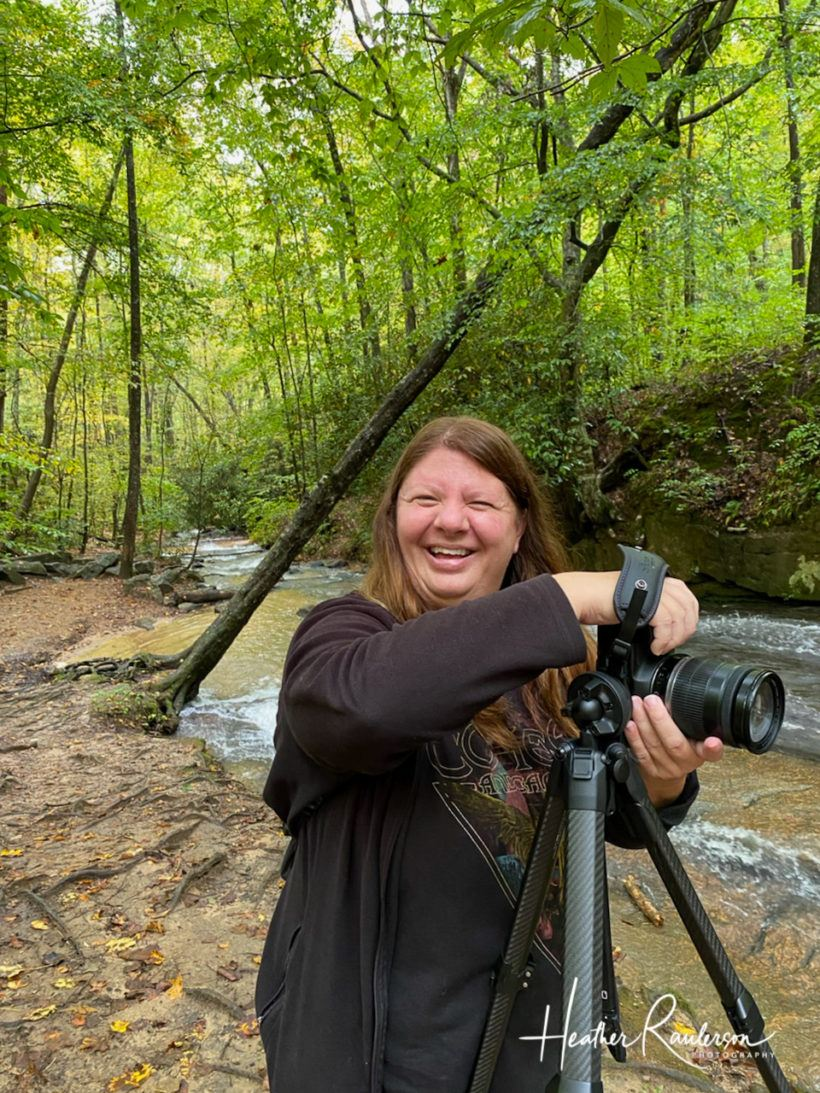 Heather smiling while taking photos at Poinsett Bridge in South Carolina