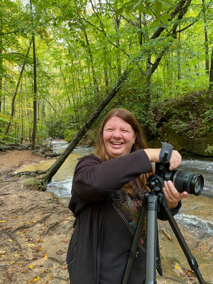Heather having fun using the Peak Design Tripod at Poinsett Bridge