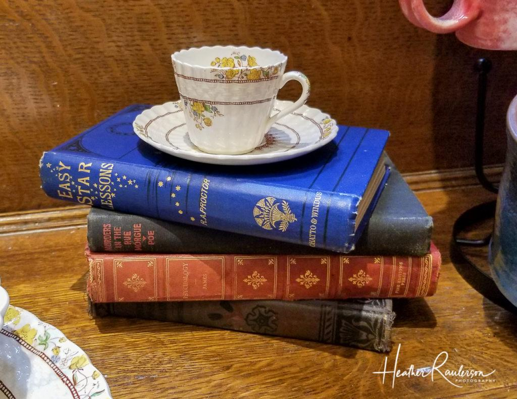 Teacup placed on a stack of books in Oakhurst